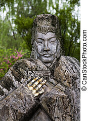 Old Stone Statue Liu Bei Three Kingdoms, Wuhou Memorial, Temple, Chengdu, Sichuan, In China. This temple was produced in the 1700s. The three warriors meet in the peach orchard.