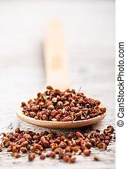 Sichuan pepper in wooden spoon