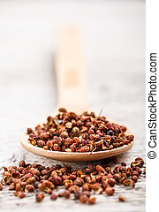 Sichuan pepper in wooden spoon