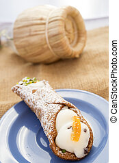 sicilian cannolo stuffed with ricotta cream