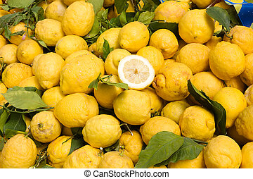 heap of italian citrons at the market - mediterranean citrus for healthy eating