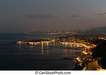 Sicilian coast in the evening near Taormina at Sicily, Italy...