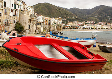 Sicilian fishing boat on the beach in Cefalu, Sicily