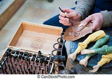 Sicilian puppet artisan at work - Sicilian puppet artisan of...