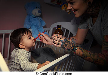 Sick baby being tended by parent