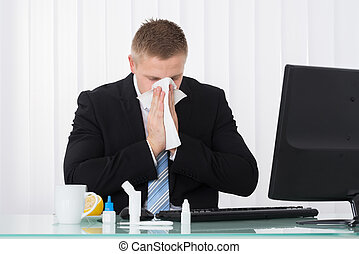Sick Businessman Blowing His Nose