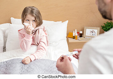 Sick child having a high fever
