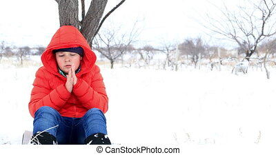 Sick child sneezing at the outdoors - Cute preteen boy...
