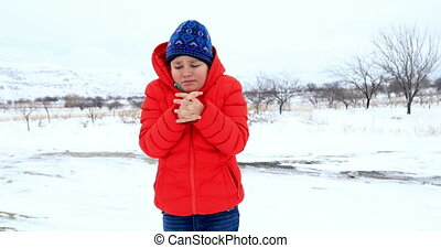 Sick child sneezing at the outdoors