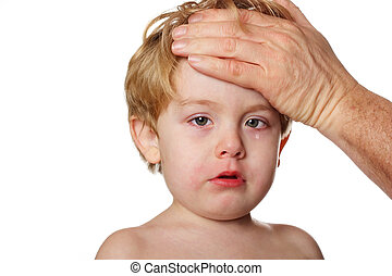 Sick child - A child with teary eyes looks sad while an...