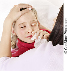 Sick child with handkerchief in bed.