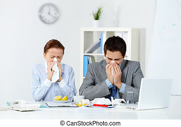 Sick co-workers - Image of sick business partners blowing...