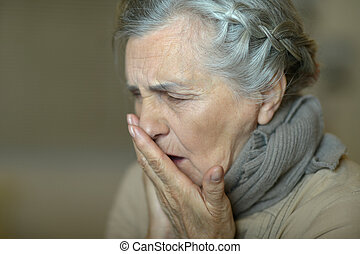 Sick elderly woman - Portrait of cute sick elderly woman...