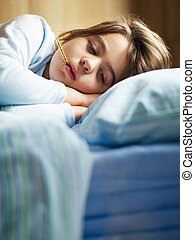 sick girl - girl taking temperature in bed. Copy space