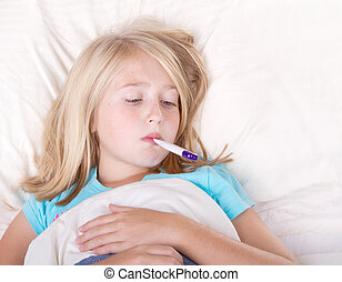 sick girl with a thermometer in mouth