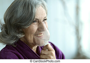 woman with inhaler - Sick happy nice senior woman with...
