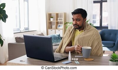 sick indian man having video call on laptop - healthcare, ...