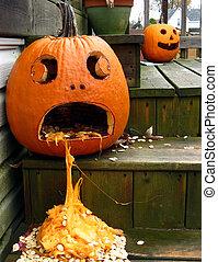 Sick Jack O Lantern - A carved pumpkin on the steps waits to...