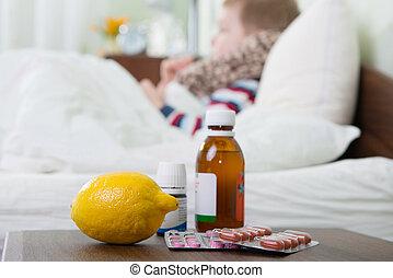 Sick little boy lying in bed