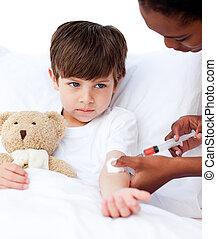 Sick little boy receiving an injection