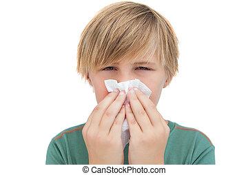 Sick little boy with a handkerchief
