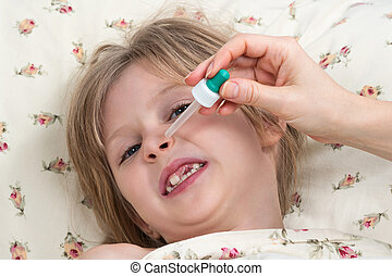 Sick little girl dripping nose with pipette