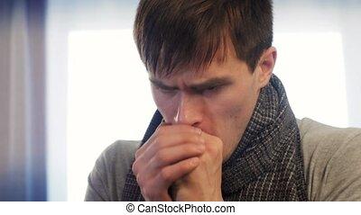 Sick man coughing really hard. Dynamic shot