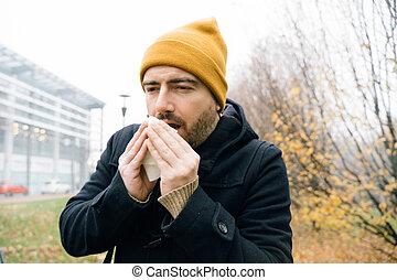 Sick man feeling bad during cold season