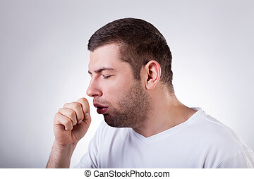 Sick man having a cough - Close-up of a young man having a...