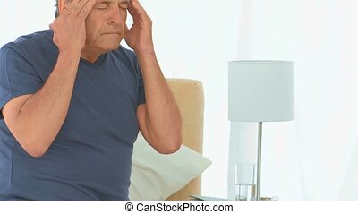 Sick man having a huge headache