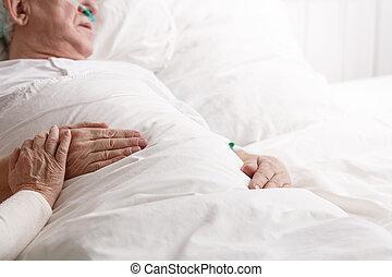 Sick man in hospital