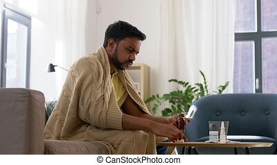 sick man pouring antipyretic medicine to spoon - healthcare...