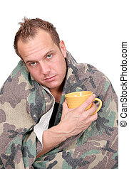 sick man - one sick adult man holding a mug wrapped in a...