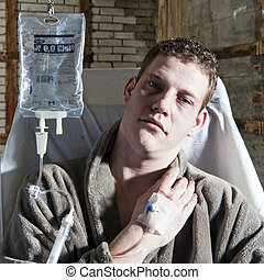 Sick man - Very sick man, with an IV drip sitting in a chair