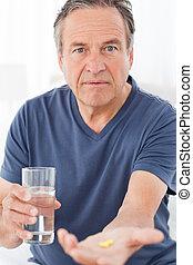 Sick man taking his pills