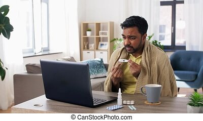 sick man thermometer having video call on laptop - ...