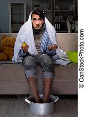 Sick man washing his feet at home