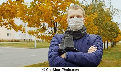sick or healthy man wearing surgical procedure mask due to...