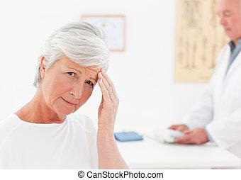Sick patient with her doctor