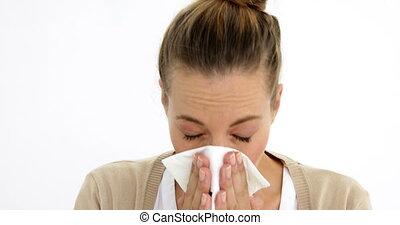 Sick ponytailed woman sneezing