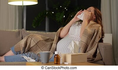 sick pregnant woman blowing nose at home - pregnancy, health...