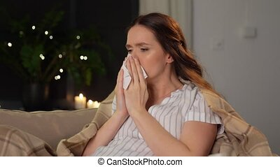 pregnancy, health and people concept - sick pregnant woman coughing at at home