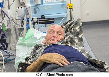Sick senior lying in an emergency room