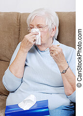 sick senior with thermometer