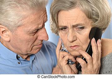Sick senior woman calling doctor