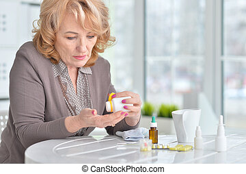 senior woman taking medicines