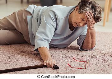 Sick senior woman with headache