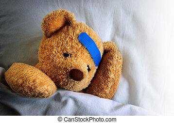 Sick Teddy - Photo of a sick teddy bear with a blue bandage...