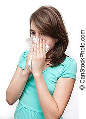 Sick teen girl using tissue