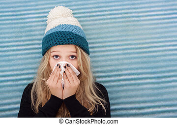 Sick teenager girl with flue - Woman with cold, blowing her...